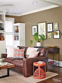 Bring high style to rooms by choosing neutral hues for anything that's expensive to update, such as floors, fixtures, and upholstery, and using accessories to introduce bold colors and textures; a neutral base lets hotter hues take center stage.