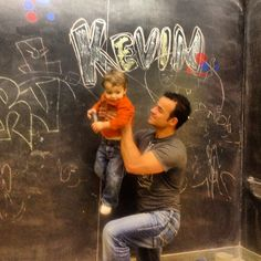 My nephew Gryphon and I drawing on the chalk board.