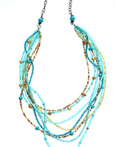 Indian Blue Turquoise and Gold Long Seed Bead Necklace. $30.00, via Etsy.