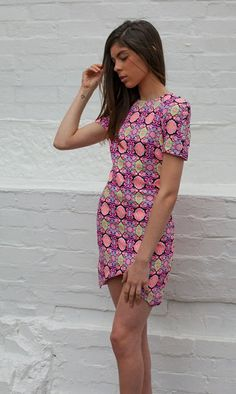 TINGLE TANGLE DRESS Boom! Crazy print in eye popping colour. Sexy cut. Perfect cut. Trust me.