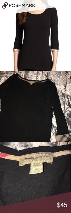 Burberry shirt AUTHENTIC The shirt is sort of like the stock foto because it is pretty much the same type of style but it has the horse in the chest area and it is authentic but because I've used it alot then I am selling it at a low price. Burberry Tops Blouses