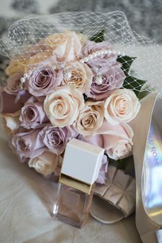 Rose wedding bouquet with 3 different coloured roses