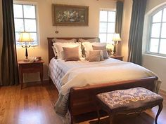 Sleeping Beauty: Featuring Ethan Allen's Chloe bed fitted with imported linens, and paired with an antique needlepoint bench.