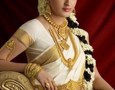 Kerala bride wearing traditional saree and bridal jewellery