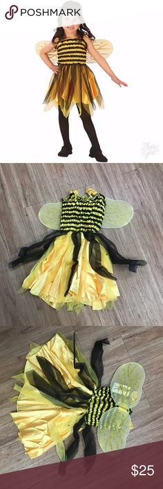 Fun World Bumble Bee Costume Wings Yellow NEW 4-6 Fun World Bumble Bee Costume Wings Yellow NEW 4-6  New in package.  Dress with attached wings.  Top portion is stretchy.  Bottom portion is tulle over satin-y skirt.  Tights and shoes are not included.  STANDARD COSTUME WORDING: Please keep in mind that costumes are not made to the standards of regular department store clothing and may have some loose stitches or seams.  If I see any holes, stains or runs I will mention them but please expect…