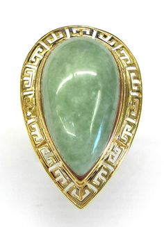 Ladies 14kt yellow gold jade estate ring. Ring contains 1 pear shape 28mm x 15mm jade gemstone. Jade is bezel set in a Greek key style 14kt yellow gold mounting.