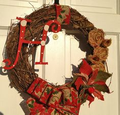Red and Tan Poinsettia Burlap Christmas Wreath - Christmas Wreath - Grapevine Christmas Wreath. $50.00, via Etsy.