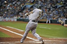 Oakland Athletics' Brandon Inge swings on a three-run home run off of Tampa Bay Rays starting pitcher Matt Moore during the third inning of a baseball game Sunday, May 6, 2012, in St. Petersburg, Fla.
