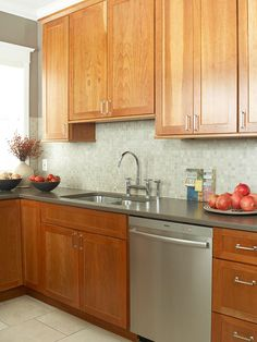 Wall color to match cabinets.   Grey green. Also accent wall a shade deeper.  For hallway and between rooms.
