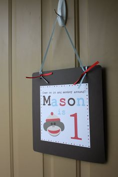 Door decoration for sock monkey party.
