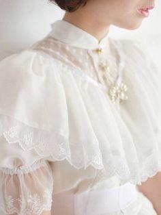 White Dress with Large Shoulder Frills ....
