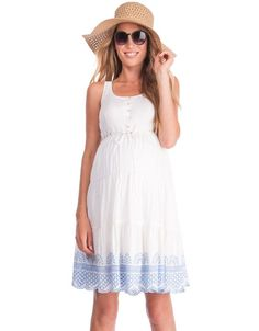 No mama's summer wardrobe would be complete without a little cotton sundress, and ours is specifically designed to work with your new curves. 100% cotton and fully lined, this white maternity dress provides a feminine drape and a flexible fit for every stage of pregnancy. A discreet stretch panel at the back offers plenty of room to grow, while drawstring ribbons at the empire waist define your shape. Pretty crochet lace detailing at the hemline is embroidered in soft sky blue for a feminine…