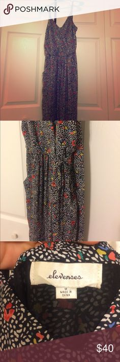 Gorgeous jumpsuit Anthropologie jumpsuit (elevenses brand) with cute retro flower print. Pockets on the sides. Wrap-look top. Tiny flaw- strap came undone, and I repaired it myself. Price reflects this. Anthropologie Other