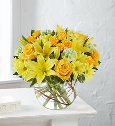 Our vibrant, summer bouquet is gathered with cheerful blooms, including yellow spray roses, Asiatic lilies, daisy poms, lime green carnations and unique curly willow tips inside a charming, petite bubble bowl. Summer Flowers To Plant, Planting Flowers, 800 Flowers, Yellow Flowers, Green Carnation, Fresh Flowers Online, Round Vase, Asiatic Lilies, Fall Plants
