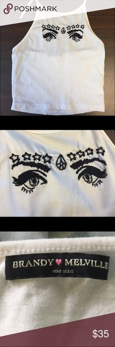 Brandy Melville Starry Eyes Sachi Halter Great condition. Barely worn. Cute eye pattern. One size. Cheaper on Ⓜ️erc Brandy Melville Tops Tank Tops