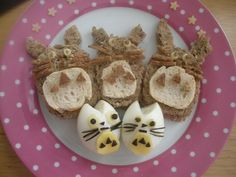 I have made my 3 little ones, 3 Totoro sandwiches and Totoro eggs. They were so excited and happy with their lunches.  I found this great site with cool art sandwich/ food art work called www.annathered.com/