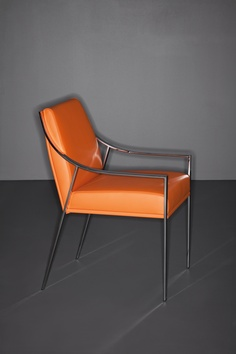 Aileron Chair with orange leather for Holly Hunt. Available at the DD Building suite 503/605 #ddbny #hollyhunt