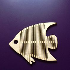 Laser cut fish toy.  A work in progress using a living hinge.  I have used a silhouette of a fish (because it is floppy) then used the school laser cutter to cut it out of laser ply.  Works well.  the kids seem to like it.
