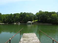 .70 acre waterfront lot with 148′ of shoreline in peaceful cove close to the main channel. Gently sloping lot is ideal for a basement. Rip rap and dock in place. Perfect location to build your dream home or use mobile home on property for a weekend getaway. Bring your own builder. No HOA. Great location, only 3 miles to 150/River Hwy and 5 miles to I-77. Walk to Stumpy Creek Park.