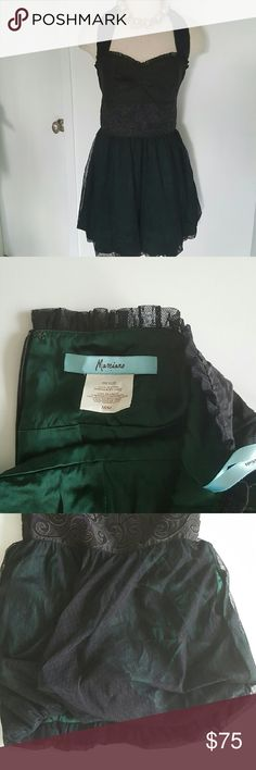"""Marciano Two Tone Halter Dress. 100 % silk beautiful dress perfect for cocktail party or dinner,  100% silk and combinations with lace and bottom,  dress with tight buster , lining forest green and body black, excellent condition been worn only few times.  Measurements are length 33"""" bust 36"""" waist 30"""" Marciano Dresses"""