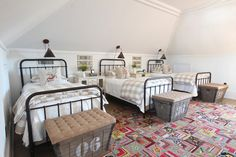 Country Living Feature | Holly Mathis Interiors bunk room, three iron beds from Restoration Hardware and linens from IKEA, trio of trunks