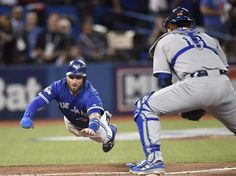 Toronto Blue Jays' Kevin Pillar, left, dives for home plate as he scores in front of Kansas City Royals catcher Salvador Perez during second inning game three American League Championship Series baseball action in Toronto on Monday, Oct. 19, 2015 (game won by the Jays). THE CANADIAN PRESS/Frank Gunn - via Montreal Gazette