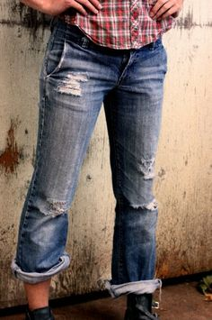 How to Distress Denim Jeans -- 1-hand new pair to my son, 2-wait one week, 3-distressed jeans complete with holes in knees and frayed hems