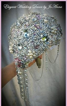 """Custom made Full brooch Bouquet This bouquet is a larger sized wedding bouquet at 9"""", which is approx 28"""" in circumference. All made and fully covered with al"""
