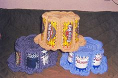 Crocheted beer can hats.