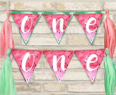 One in a melon party banner for watermelon theme first birthday party.
