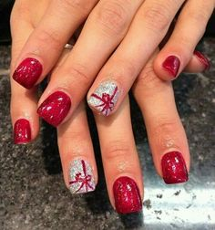 Christmas Present Nails.  All red nails with white bows on ring fingers.