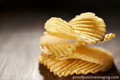 CRINKLE CUT POTATO CHIPS Ruffled potato chips stacked for your snack.  http://proofpositiveimaging.photoshelter.com/gallery-image/Food/G0000vxWBxmMXSBY/I0000ZNZdD6zNJWg/C00004tzArDrbjNQ  © Jennifer Hill, Proof Positive Imaging Photographer Jen Hill