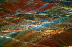The Zhangye Danxia Landform in Gansu, China, is formed out of colored rocks resulting from red sandstone and deposits of minerals building up over the course of 24 million years.