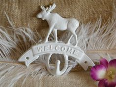 Wall Hook / Welcome - White Moose Wall Hook-Cast Iron-Rustic Home Decor-Lodge Decor-Entryway Decor. $13.25, via Etsy.
