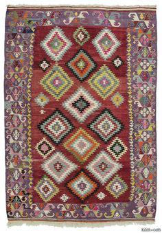 Cheerful vintage kilim rug hand-woven in Manisa, Turkey in the Aegean region in 1960's. This tribal kilim is in excellent condition.