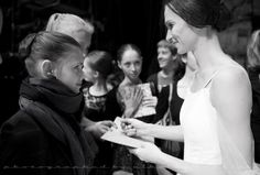Polina Semionova signing autographs. You can see the admiration in the young girls eyes to be like her one day.