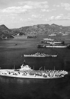HMS Unicorn (I72), USS Juneau (CLAA-119), USS Valley Forge (CV-45), USS Leyte (CV-32) and USS Hector (AR-7) at Sasebo, Japan, 1950.