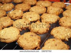 Cashew nut cookies on steel grid after oven - stock photo