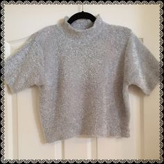Silver Sweater Top Size M Oh so soft!! This was worn once, washed, and put away waiting for PoshMark  to arrive.  Hand wash, size medium, and perfect for the holidays.  Can be layered with a light frilly tank to give it a double layer look. Newport News Sweaters Crew & Scoop Necks