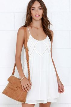 As soft as a mountain breeze and sweet as ice cream, the Easy Honey Ivory Slip Dress is a total treat in everyday proportions! Lightweight woven rayon falls into a triangle bodice with scoop neckline, spaghetti straps, and elegant pierced designs. Relaxed skirt reveals a bit of the lining for a cute tiered effect. Hidden back zipper. Fully lined. 100% Rayon. Imported.