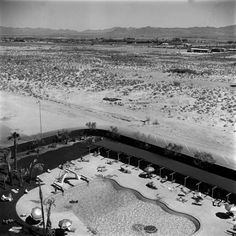 ...the desert city has steadily grown from a 100-acre (40 hectare) railroad town in 1905 to a sprawling metropolis of close to 2 million people today [1955]. But no matter the odds, Las Vegas always seems to have one more ace in the hole, one more trick up its sleeve to keep the lights on, the casino floors humming and the dreamers coming back again and again.