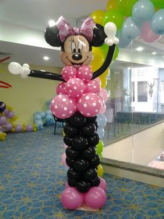 Como hacer una minnie con globos / how to make minnie mouse ballon