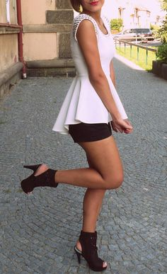 white peplum shirt and black shorts