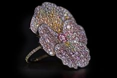 David Michael Violet ring with pink, yellow an colourless diamonds