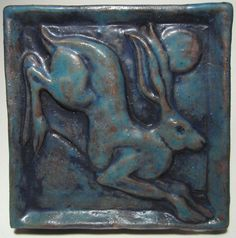 ****AVAILABLE NOW. NO WAIT TIME****  Hand sculpted and pressed in red earthenware from my original mold. The tile is glazed with a non-commercial turquoise semi-gloss glaze which accents the dimension of the piece, and produces an antique effect.   Measures 4 square and is approx. 3/4 thick.  A depression on the back allows this extra-thick tile to be hung on a wall.