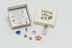 "Little Life Kit- A gorgeous little box containing words and objects to inspire life's journey. "" my hopes for you are that . . . you always reach for the stars, your heart is free and you have the chance to follow it, you learn the best luck of all is the luck you make for yourself, you don't dream your life, but live your dreams, you set your goals high, and don't stop till you get there, you have the courage to grow and become who you really are and that when it rains, you see rainbows'"
