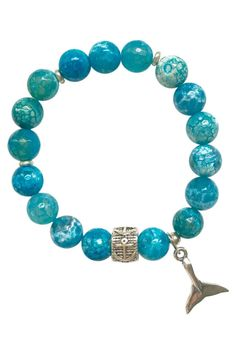 """Handcrafted bracelet with turquoise agate beads, a sterling silver whale's tail and an anchor rondelle bead. Summer style to the max! This bracelet stacks beautifully with your other beaded or silver bracelets. One size fits most; the bracelet measures approximately 7"""" in diameter and is strung on durable elastic.   Whale Tail Bracelet by MellBee Designs. Accessories - Jewelry - Bracelets Cape Cod, Massachusetts"""