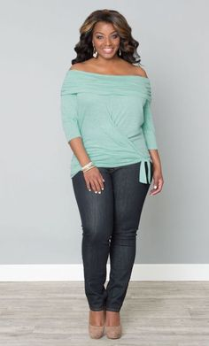 Plus sized pastel green tank top blouse with denim jeans.  Very appealling