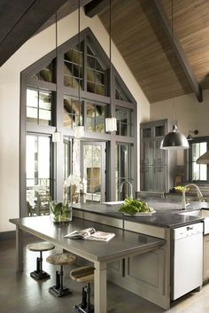 Incredible door between the kitchen and all-season room, and awesome pull-out bar! I love the natural neutrals used here.