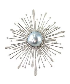 Don't be caught wearing a plain strand of pearls while these treasures are trending. Pictured: Vintage Star Burst brooch in 18-karat white gold with Natural South Sea Baroque pearl and diamonds, $52,000, COACH HOUSE.